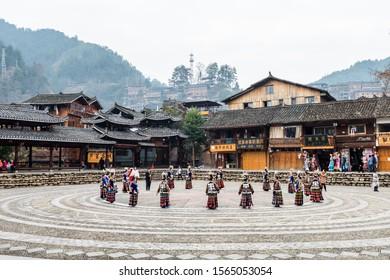 Guizhou, China, Jan 21, 2019, The Chinese miao women wearing traditional clothes and dancing in open opera house of Xijiang Qianhu Miao Village (The One Thousand Household Miao Village) , in southeast