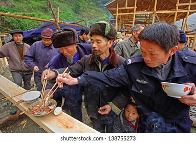 GUIZHOU PROVINCE, CHINA - APRIL 16: Langde Miao ethnic minority village, Leishan County, Guizhou, China, April 16, 2010. Ritual began building a house. Guests of the holiday eating fish.