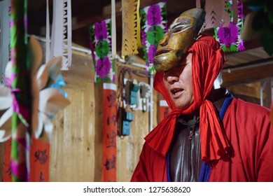 GUIZHOU PROVINCE, CHINA – CIRCA DECEMBER 2018:  The ritual redeeming the vow'in a village of Guizhou province accompanied by theatrical performance did by the ritual masters and his assistants.