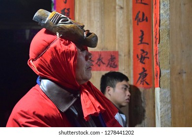 GUIZHOU PROVINCE, CHINA – CIRCA DECEMBER 2018: The ritual redeeming the vow'in a village of Guizhou accompanied by theatrical performance did by the ritual masters. Translation of text: worship nature