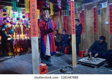 GUIZHOU PROVINCE, CHINA – CIRCA DECEMBER 2018: The ritual redeeming the vow in a village of Guizhou accompanied by theatrical performance did by the ritual masters. Translation of text: worship nature