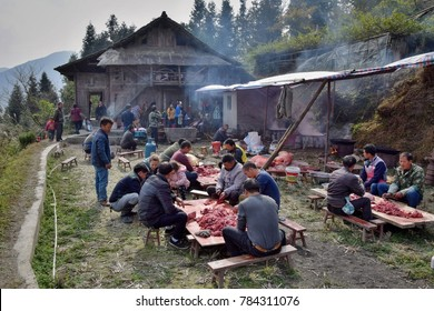 GUIZHOU PROVINCE, CHINA – CIRCA DECEMBER 2017:  A pig-slaughtering feast on the occasion of a wedding. People preparing food for wedding feast.