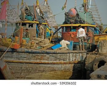 GUJARAT, INDIA - NOVEMBER 3, 2016: Part of the large local fishing fleet docked at the port of Vanakbara on Diu Island. Their catch is being dried in the sun on racks before sale at the local market