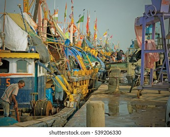 GUJARAT, INDIA - NOVEMBER 3, 2016: Part of the large local fishing fleet in dock at the port of Vanakbara on Diu Island. The fishery in the Arabian Sea is one of the mainstay's of the island's economy