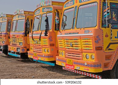 GUJARAT, INDIA - OCTOBER 30, 2016: Fleet of trucks parked up on an industrial site. India has the second largest network of roads in the world and its economy is heavily dependent upon road haulage