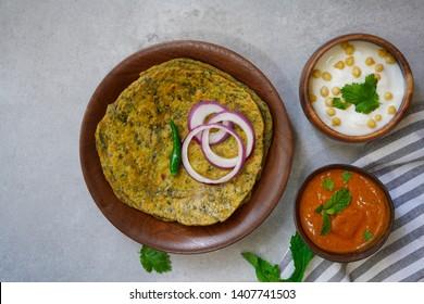 Gujarati Methi Thepla - Indian flatbread Paratha with fenugreek leaves, selective focus
