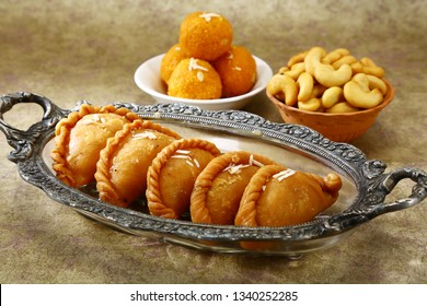 Gujiya,  Sweet deep-fried dumpling made with suji, Indian sweet