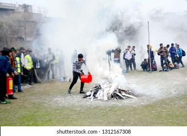GUJRANWALA, PAKISTAN - FEB 13: Students of the Government Islamia Collage are Actively participating in emergency relief and fire-fighting training conducted by CDD on February 13, 2019 in Gujranwala.