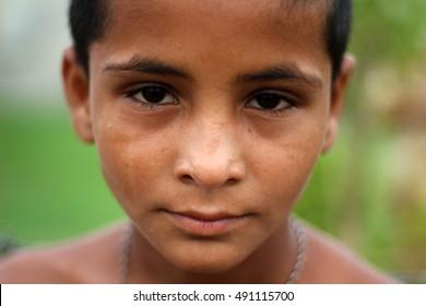 GUJRANWALA, PAKISTAN - JULY 24, 2014: Portrait of an unidentified boy on the street in  city of Gujranwala, Pakistan