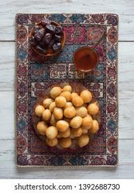 Gulab Jaman - diwali sweets on a white wood background.