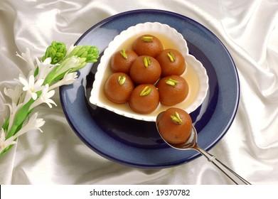 Gulab Jaman in Heart Shape Dish, Indian & Pakistani peoples favourite dessert.