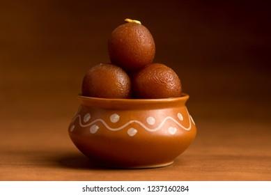 Gulab Jamun in clay pot. Indian Dessert or Sweet Dish