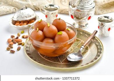 Gulab Jamun in crystal bowl with arabian crockery