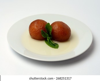 Gulab Jamun - Indian dessert made from milk solids and served in a coating of sugar syrup.