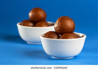 Gulab Jamun with Pistachio, Indian Dessert or Sweet Dish in bowl.