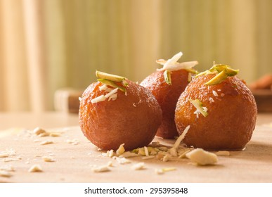Gulab Jamuns, Indian dessert topped with Cashews, pistachio and almonds.
