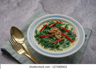 Gulai Daun Singkong / Indonesian food made from Tapioca or cassave leaves /kale cooked with coconut milk