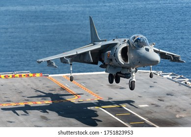 GULF OF CADIZ, SPAIN, SEPTEMBER 12, 2019: An AV-8B Harrier fighter jet of the Spanish Navy is ready to land at the Juan Carlos I aircraft carrier on September 12, 2019 at the Gulf of Cadiz, Spain.
