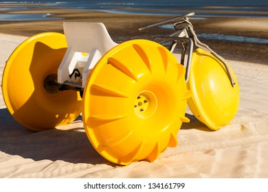 Gulf coast beach in Biloxi, Mississippi with a water tricycle.
