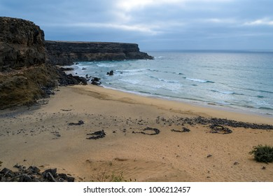 gulf of Esquinzo, wide beach for surfers, hidden among volcanic rocks and ocean waves, Fuerteventura, Canary Islands, Spain