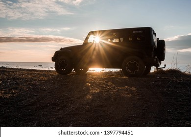 Gulf of Finland. Leningrad region, Russia, April 14, 2019: jeep Wrangler on the coast of the Gulf of Finland. Wrangler is a compact four wheel drive off road and sport utility vehicle