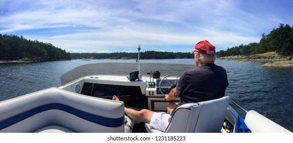 Gulf Islands, British Columbia, Canada - June 30th, 2016: A man enjoying travelling around the Gulf Islands near Vancouver, British Columbia, during the Canada day long weekend.