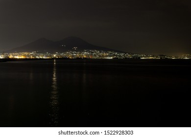 the gulf of naples by night with vesuvio and lighthouse