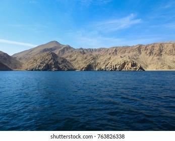 Gulf of Oman coast. Mountains of Al Hajar (Rocky mountains). Arabian peninsula