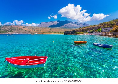 The gulf outside of the amazing caves of Dirou with fishing boats and turquoise waters, Peloponnese, Greece.