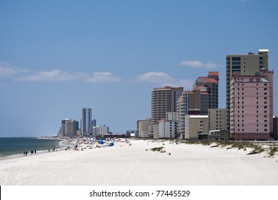 "GULF SHORES, ALABAMA - MAY 15: Gulf Shores is known for its bright, ""sugar white"" quartz sand that many people are enjoying on May 15, 2011 in Gulf Shores, Alabama"