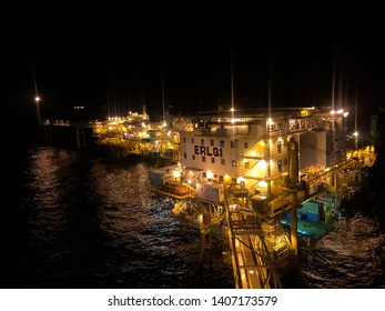 Gulf of Thailand, Erawan Gasfield, Thailand : May 25, 2019 - Offshore living quarter with flare tower at night time,large offshore oil rig at night twilight with Gangway, Erawan LQ Chevron thailand