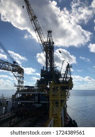 Gulf of Thailand, Thailand- May 7,2020 : Offshore  tower tender rig or barge or Derrick of Tender Assisted Drilling Oil Rig (Barge Oil Rig) on The Production Platform During cloudy sky. silhouette