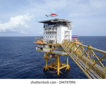 GULF OF THAILAND,THAILAND- JULY 31 12: Helicopter landing at offshore petroleum production platform. Offshore platform located in gulf of Thailand on July 31, 2012.