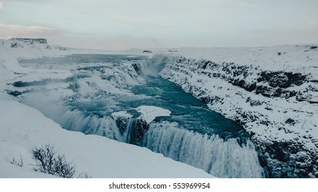 Gulfoss Golden Falls waterfall Iceland in winter, with blue water and creative toning applied