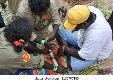 Gulkula, East Arnhem, NT, Australia - August 2010: Dhimarru Indigenous Rangers teaching traditional fire making at Garma Festival