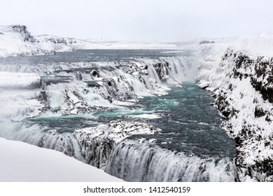 Gullfoss  (Golden Falls) waterfall view in the canyon of the Hvita river during winter snow Iceland