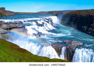 Gullfoss, Iceland - May 30 2019:  Golden Ring area,  view of the Gullfoss waterfalls with visitors on the left