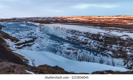 Gullfoss waterfall Iceland with snow in winter. Dramatic landscape of this majestic waterfall in the Icelandic Golden circle. Travel and nature concepts.