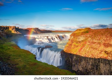 Gullfoss waterfall, also known as the Golden Falls, and the Olfusa river in southwest Iceland with a rainbow. Long exposure.