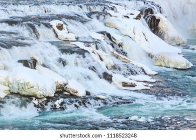 Gullfoss waterfalls located along the golden circle route, Iceland during Winter season. Ice, snow, water and sunset.