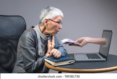 Gullible senior old lady being lured into an online scam that promises easy money, money fraud concept