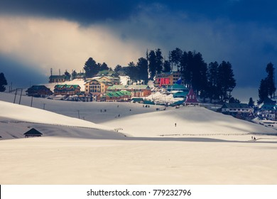 Gulmarg Village in the middle of Himalaya mountain at Kashmir. Snow village at Gulmarg in India. Landscape of beautiful nature of Himalaya mountain at blue sky.