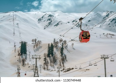 Gulmarg,15,April,2016 Jammu and Kashmir,India,Aerial view from red Gondola cable car showing  snow  covered  mountains with alpine trees   and transportation system,Jammu and Kashmir,India,Asia