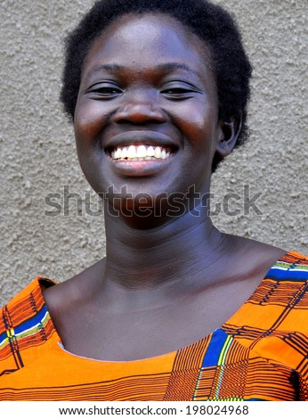 GULU, UGANDA, AFRICA - CIRCA MAY 2009: Portrait of a woman from Uganda, Africa circa May 2009. In Uganda, women's roles within the community are slowly improving with increased educational programs.