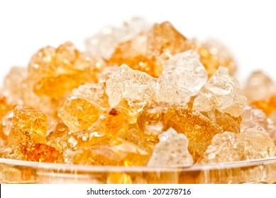 Gum arabic pieces in glass
