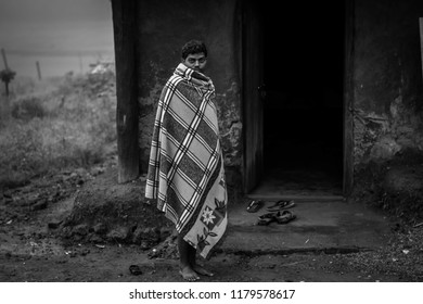 Gumla/India 5 September 2018, picture of tribal man standing in front of his house at Gumla, Jharkhand,India