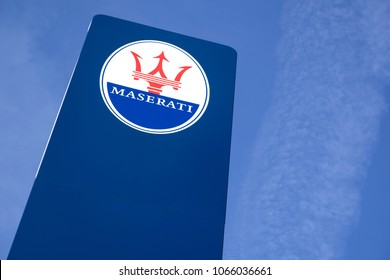 GUMMERSBACH GERMANY - April 7, 2018: Maserati dealership sign against blue sky. Maserati is an Italian luxury vehicle manufacturer established on 1 December 1914, in Bologna.