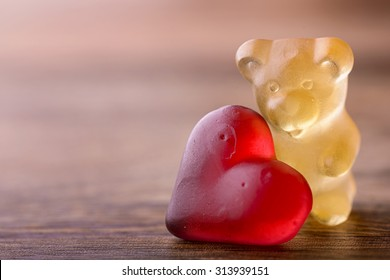 gummy bear with red heart on wood for valentines