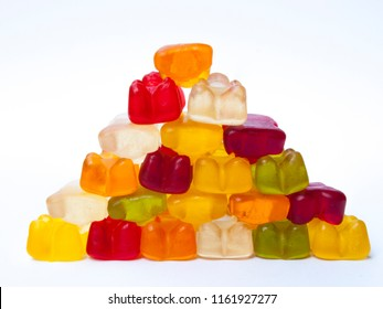 Gummy bears candy in pyramid shape, on white isolated background.