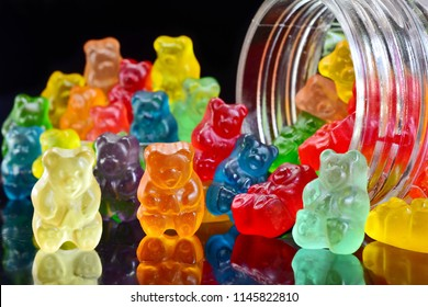 Gummy bears on the beach background
